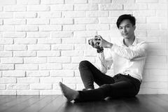 Asian man with a camera black and white Stock Image