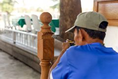 Asian man carpenter treating a wooden with chisel outdoor. Asian man carpenter treating a wooden with chisel outdoor stock photography