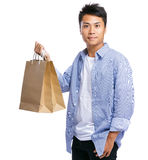 Asian man carry paper bag Royalty Free Stock Photos