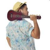 Asian man carry ukulele. With isolate blackground stock photo