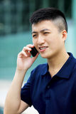 Asian man with cell phone Royalty Free Stock Image