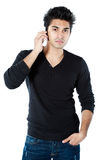 Asian man with cellphone Royalty Free Stock Image