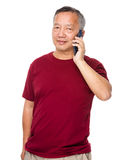 Asian man chat on cellphone Stock Images