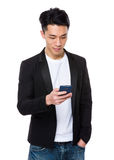 Asian man check the email on cellphone Stock Image