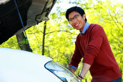 Asian man checking his car engine Royalty Free Stock Image