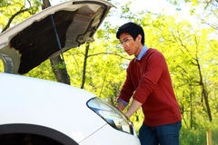 Asian man checking his car engine Stock Image