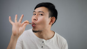Asian man with chicken bone. Royalty Free Stock Photos