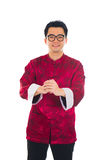 Asian man with Chinese traditional dress cheongsam and gong xi f Royalty Free Stock Photos