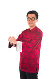 Asian man with Chinese traditional dress cheongsam and gong xi f Stock Photos