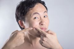 Asian man cleaning face royalty free stock photo