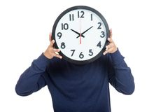 Asian man close his face with  a clock Royalty Free Stock Image