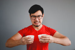 Asian man and coffee cup. Royalty Free Stock Photos