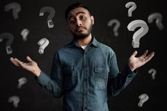 Asian men confused and unsure expression. Asian man confused and unsure expression royalty free stock photo
