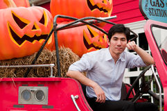 An asian man cross his arm and lean against truck Royalty Free Stock Photos