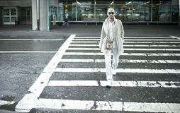 Asian man crossing road Royalty Free Stock Images