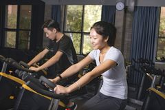 Asian man cycling exercise bikes at the gym Stock Image