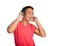 Asian man dances as he listens to his headphones. Stock Images
