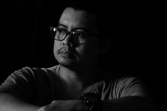 Asian Man in the Dark sad mood Royalty Free Stock Images