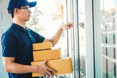 Asian man Delivery service courier Knock the door house with boxes in hands.  stock images