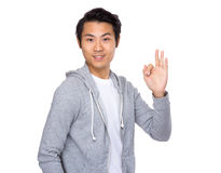 Asian man doing the okay gesture Royalty Free Stock Photos