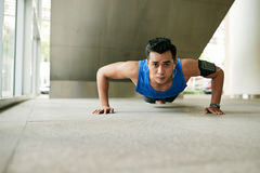 Asian man doing plank exercise Royalty Free Stock Image