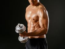 Asian man doing single bicep curl Royalty Free Stock Images