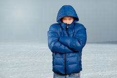 Asian Man in Down Padded Coat. Asian man in blue down-padded coat Royalty Free Stock Images