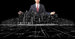 Asian man and drawing of modern building construction on black Royalty Free Stock Photography