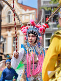 Asian man dressed in ancient Chinese opera costume participates in Tilburg T-parade, Netherlands royalty free stock photo