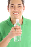 Asian man drinking bottled water Royalty Free Stock Photos
