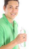 Asian man drinking bottled water side Stock Images