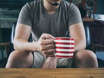 Man drinking hot coffee tea or cocoa. stock images