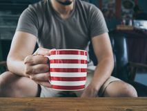 Man drinking hot coffee tea or cocoa. stock photo