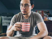 Man drinking hot coffee tea or cocoa. royalty free stock image