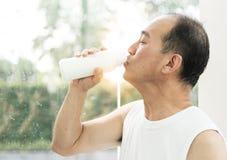 Asian man drinking milk. Stock Photo