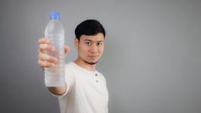 An Asian man drinking water. Stock Photo