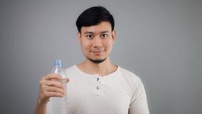 An Asian man drinking water. Stock Images