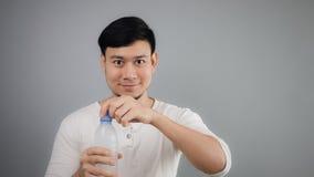 An Asian man drinking water. royalty free stock image