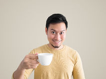 Asian man drinks coffee. Royalty Free Stock Images
