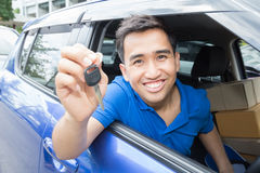 Asian man driver smiling and showing car key stock photo
