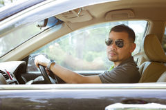 Asian man driving in car Royalty Free Stock Photos