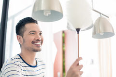 Asian man dusting his home Royalty Free Stock Photo