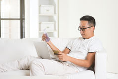 Asian man earning cash Stock Photography
