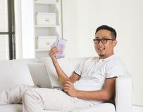 Asian man earning cash Stock Photo