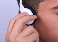 Asian man with earphone Royalty Free Stock Photos