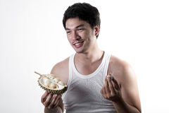 Asian man eating Durian Royalty Free Stock Images