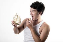 Asian man eating Durian Royalty Free Stock Photo