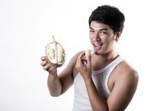 Asian man eating Durian Royalty Free Stock Image