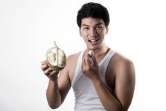 Asian man eating Durian Stock Photography