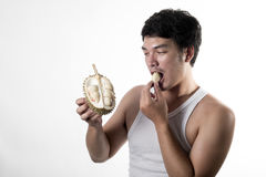 Asian man eating Durian Stock Image